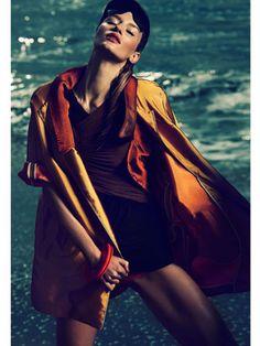 Gold jacket & orange jacket: Albino; dress: Donna Karan New York; bikini bottom: Zero+Maria Cornejo; visor: Perrin Paris 1893; bangles: Alexis Bittar.