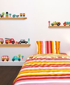 I like these wall decals, mostly because Drew's so into vehicles.  And because they're supposedly easy to remove.