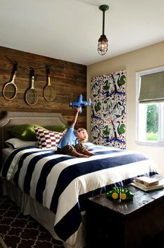 Navy and white striped bedding - Navy is a classic color that has made its way back to trend forward kid bedroom, color, stripe bed, striped bedding, tenni, white bed comforters, boy room, wood walls, wooden walls