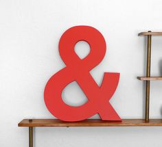 color red, wood ampersand, red red, walnuts, letters, black white red, letter red