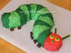 Coolest Very Hungry Caterpillar Cake using bundt cake, a loaf cake, Hershey's kisses (eyes), sprees(face), and fruit twists (antennae).