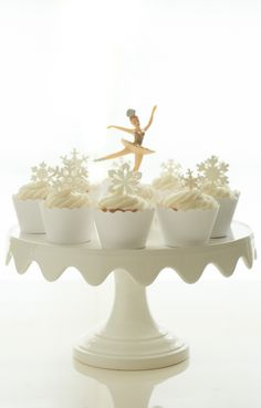 Martha Stewart for Macy's cake stand, One Girl Cookie cupcakes, Bella Couture white cupcake liner, NY Cake and Bake ballerina topper, SugarPetals-usa sugar snowflakes