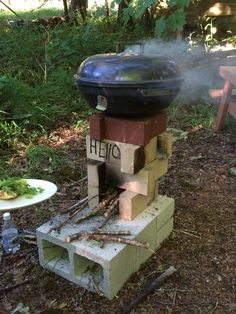 """Rocket stove pizza oven dry stacked. 4"""" hole was cut into the bottom of an old grill. Use apple, alder, rosemary wood for a great smoky favor. The secret to the rocket stove is adjusting the air tray, about 1"""" for this stove."""