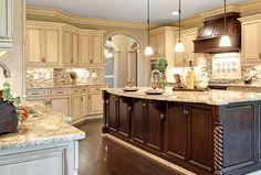 Kitchen Design Gallery | Marsh Kitchens, white cabinets, white granite, white, brown, grey tile backsplash, dark wood kitchen island, dark wood oven hood, open concept. hard wood floors