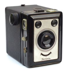 """Ferrania Zeta Duplex    With this design, Ferrania made it easy to """"smile for the camera"""".    The Zeta Duplex is a metal box camera, made in Italy c1940-45. Exposures (on 120 film) can be 6x9cm or 6x4.5cm, and I'm guessing that's why it's called """"Duplex""""."""