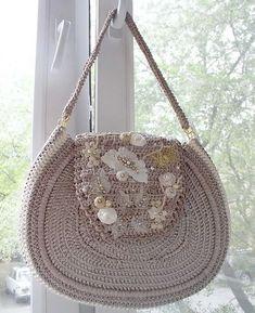Crocheted handbag with ribbons