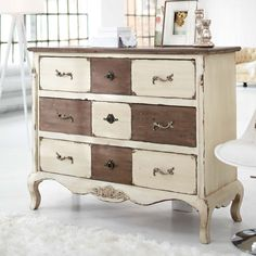 Alternated drawers are left natural, or stripped if needed, while the rest is painted off white. Then a little distressing. Nice look.