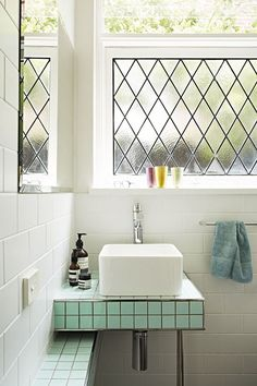 Windows and plain white tile bathroom