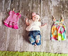 This my be the cutest picture I've ever seen. I will have to do this one. Was just thinking how hard it will be to pick just one outfit for C to wear in her 6 months pics! :)