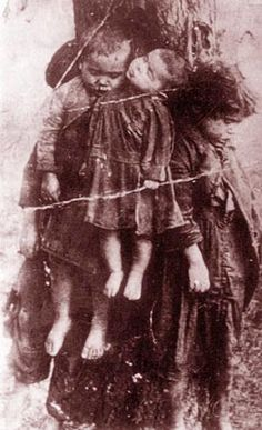 Here is the story: Dead children tied to a tree, Village of Kobzowa (powiat of Tarnopol), 1923. Four killed Roma children tied to tree by their mentally ill mother after her husband was arrested and her Roma group dissolved. The murder took place in night of 11/12 December 1923. children tie, ukrainian nationalist, human behaviour, dead children, occupi poland, genocid commit