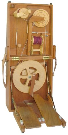 The Journey Wheel: Inspired by the Indian charkha, but has foot treadles and multiple spinning ratios. Crafted out of cherry wood, and folds into a small carrying case.