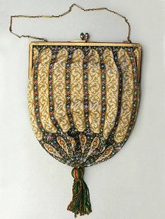 Tiffany & Co. microbeaded evening bag, ca. 1920. 14K gold frame with cabochon emerald clasp.