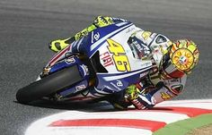 This iconic elbow dragging image was shot during qualifying the day before Rossi defeated Yamaha team mate Jorge Lorenzo in a historic last lap last corner pass on route to his last MotoGP World Championship for Yamaha. by jacquiedwards