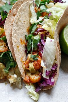Spicy Shrimp Tacos with a Southwest Avocado Sauce Recipe ~ Spicy Shrimp, drizzled with a cool, creamy Avocado Sauce are all wrapped up with crunchy lettuce to make some fabulous Tacos!