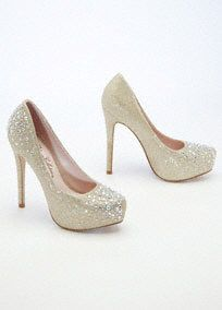 "Be the talk of the town in these out-of-this-world crystal platforms!  High heel glitter mesh platform pump features sparkling crystal detail.  Heel measures 5"". Platform measures 1"".  Fully lined. Imported."