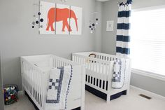 We love the simple animal silhouettes in this modern twin boys nursery!