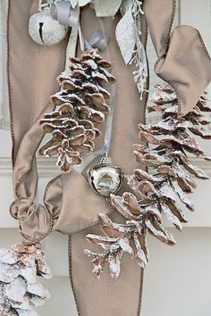Frosted pine cones and bells