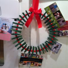 Christmas card wreath holder. Clothes pins, wooden beads and wire coat hanger.