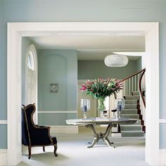 beautiful color choice and chandelier for this entry hall