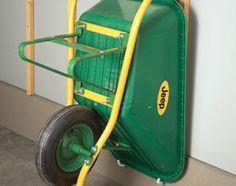 Plumbing hook wheelbarrow storage
