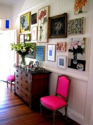 love the gallery wall, neon pink chairs, and the dresser.