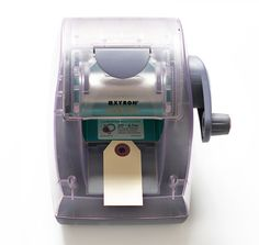 Xyron Sticker Maker I Adds adhesive to the back of anything, allowing you to easily make stickers/labels. #diy