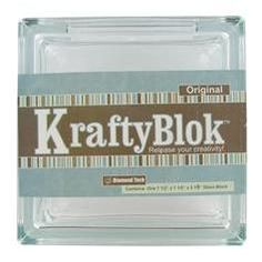 "This Krafty Blok Glass Block from Diamond Tech is versatile and with a little creativity can be turned into a bank, decorative lighting, bookends, vase and more. The block measures 7 1/2"" x 3 1/8"" x 7 1/2"". There is a 4 3/8"" x 1"" opening on the top and it comes with a plastic topper. $11.99"