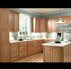 Oak cabinets with blue/green walls
