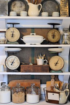 Beautifully decorated kitchen shelf with 4 lovely vintage scales
