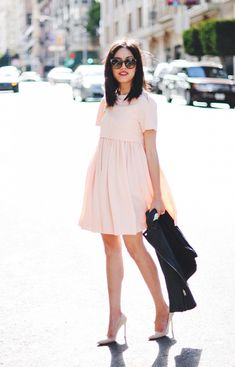 Take a note from Anh and layer a sleek moto jacket over a sweet babydoll dress. // #Fashion