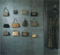 A collection of purses on a wall, a whimsical touch.I have 5 so far. I have them on wall in my bedroom around a picture of a vintage lady.