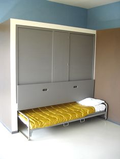 hideaway bed in le corbusier house - looks like the bed pulls out from the bottom of a closet. Clever!