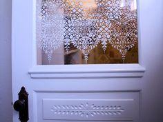 Stenciled glass in door.  I believe this is Epoch Design's Rococo stencil (found here: http://www.mbhistoricdecor.com/Victorian/Moorish.html)