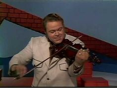 Roy Clark - Orange Blossom Special::As performed on the HeeHaw television show. Not only was Roy Clark an extraordinary musician - Best Known for his Guitar work - but he was aknowledged to be one of the nicest guys in the entertainment industry. A truly good soul.