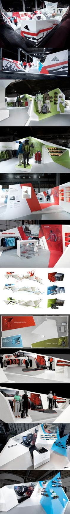 Adidas Outdoor Exhibition Stand 2009 | The Adidas Outdoor exhibition stand rises like mountains dynamically into the space. A winding band divides the different product groups, and 2D graphics turn into 3D bodies.