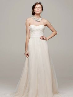 We can just picture this breathtaking soft tulle skirt blowing in the wind on a Caribbean beach. This strapless A-line beaded lace wedding dress from David's Bridal is perfect for a destination wedding!