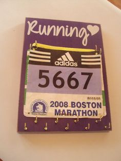 Race bibs  medals holder -- This is such an awesome idea! I have mine in a drawer right now. Want!