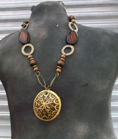 Unique Statement Piece, Necklace with wood pendant,  gold chain, wood and cats eye beads and free matching earrings. $25.00, via Etsy.