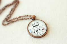 ad lib necklace made from vintage sheet music...perfect for an actor or actress!