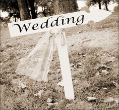 Outdoor wedding sign - Photo by Jeremy