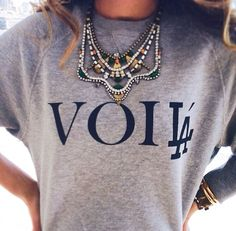 Statement necklace with sweatshirt. Sporty chic!