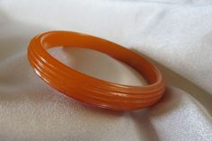 Vintage orange ribbed bakelite bangle bracelet ~ $72!