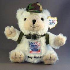 SOMETHING TO HUG (My Hero Photo Bear) - The My Hero Photo Bear is a perfect plush companion for children with deployed parents. The plastic sleeve on the bear's stomach allows a small photograph to be inserted so children can keep a picture of their hero close.