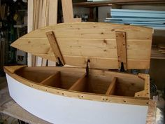 Wood Boat Toy Box Nautical Chest Hand Crafted Bookshelf canoe. $195.00, via Etsy.
