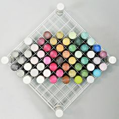 Make your own craft paint storage from wire shelves and PVC pipe. Instructions @ http://www.madincrafts.com/2012/09/craft-room-organization-pvc-and-wire.html