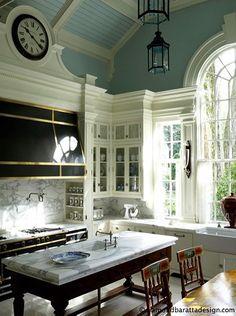 Great molding, ceiling, marble island and backsplash