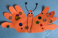 Spring Craft for young children:  Hand print butterfly craft.
