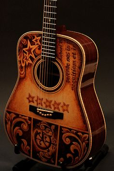 Handmade Acoustic Guitars by custom guitar builder Jay Lichty, artwork by Clark Hipolito