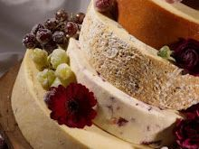 """Cheese wheel wedding cake.  So delicious, but how do we get around """"they will now cut the cheese""""? lol"""