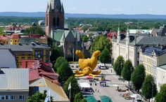 Why yes that is a gigantic yellow rabbit in the middle of that city.